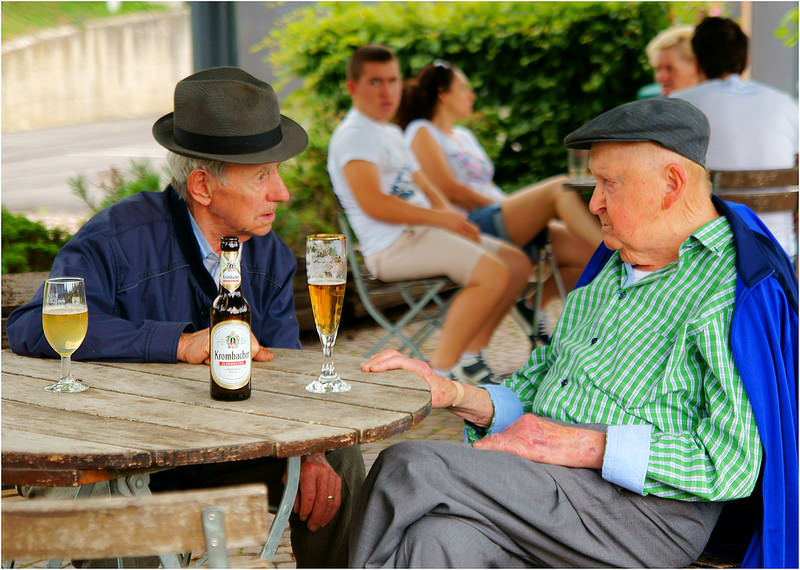 old men drinking beer